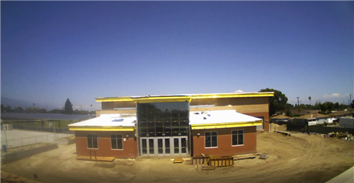 "The Wellness, Arts & Technology Center - Progress Photo ""Exterior windows installed and interior work being done"""